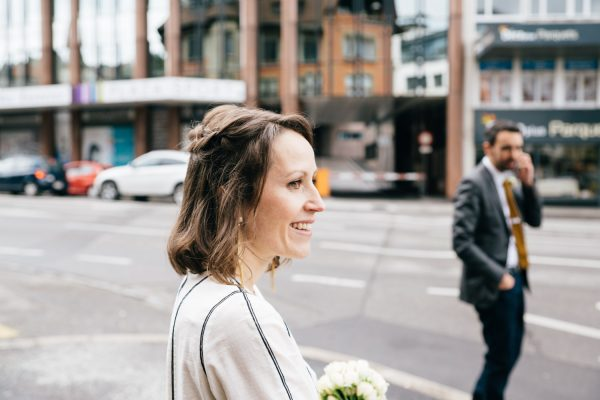 Smily bride waiting in the streets- Simple and elegant wedding in Geneva